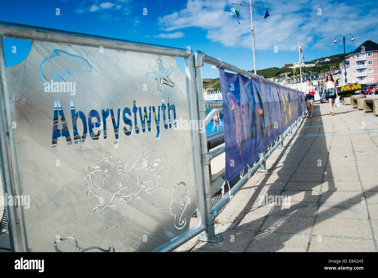 Aberystwyth town name cut out in stencil lettering on a metal gate to childrens paddling pool, Wales UK - Stock Image