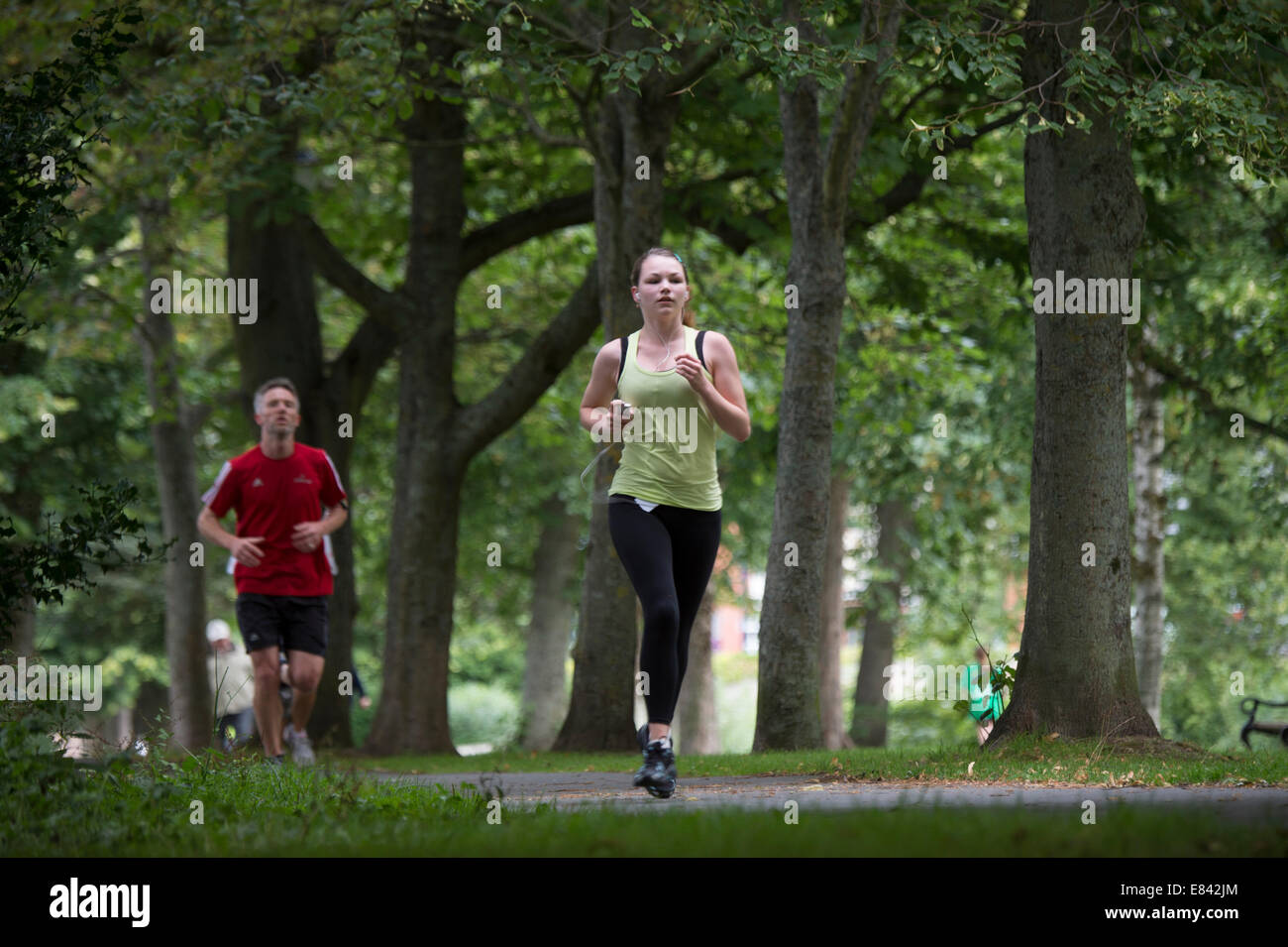 Runners of all ages taking part in the global weekly 5k Adidas-sponsored 'ParkRun' in Plascrug avenue, Aberystwyth - Stock Image