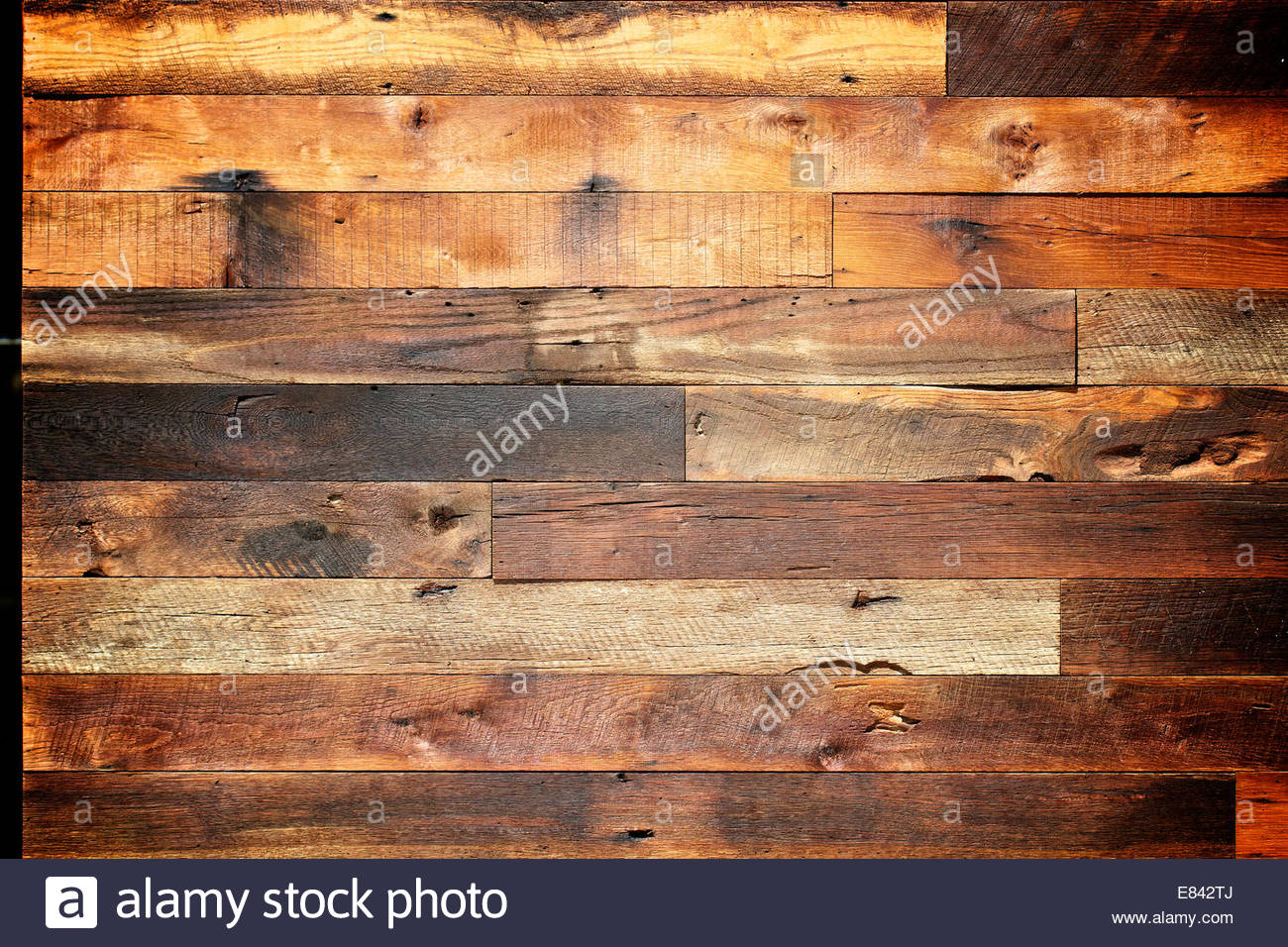 Shabby, reclaimed rustic weathered textured barn wood background wall - Stock Image