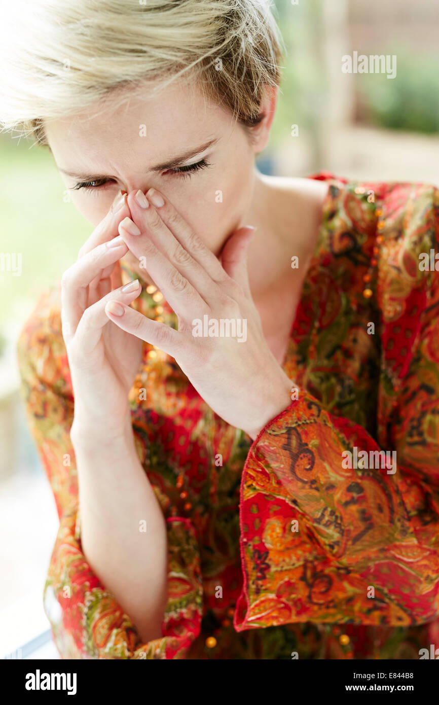 Girl with blocked sinuses - Stock Image