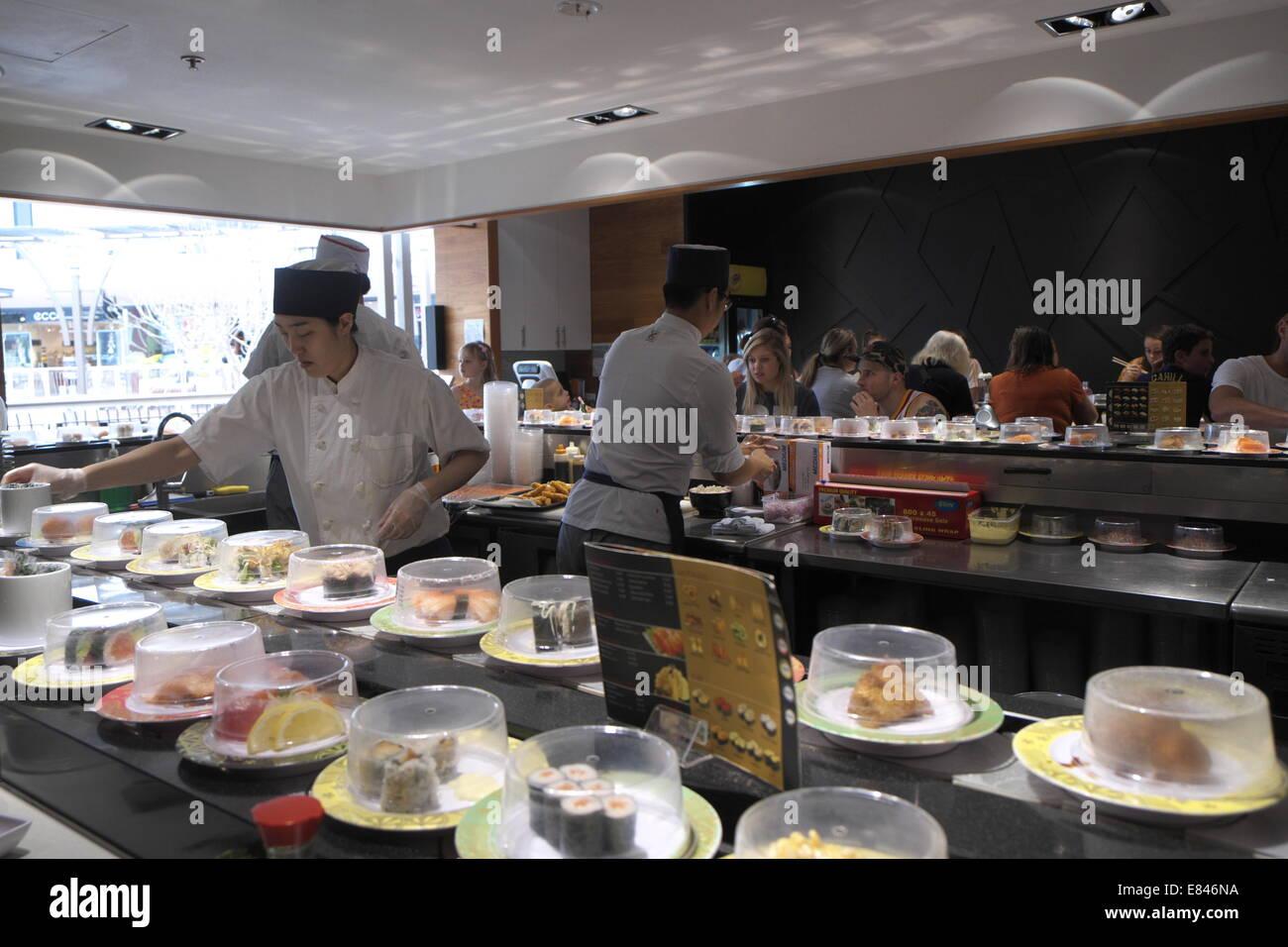 Japanese Restaurant Selling Sushi On A Train Revolving