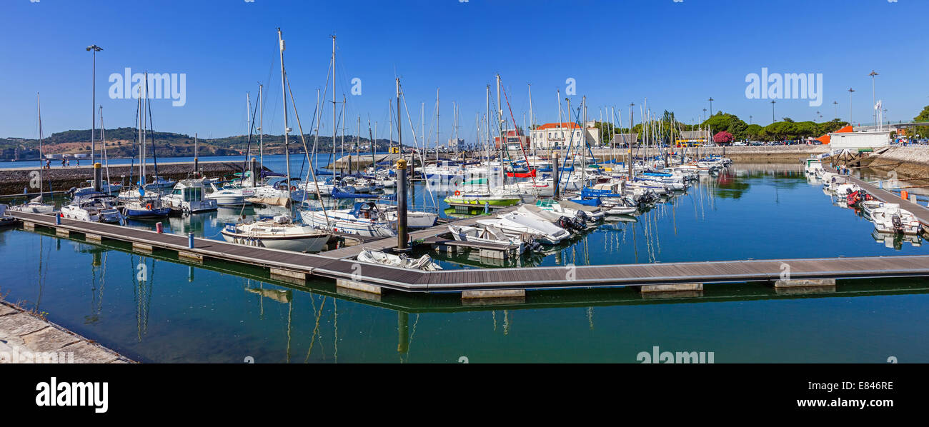 Doca do Bom Sucesso Marina in Belem district filled with docked yachts, sailboats and motorboats during summer. - Stock Image