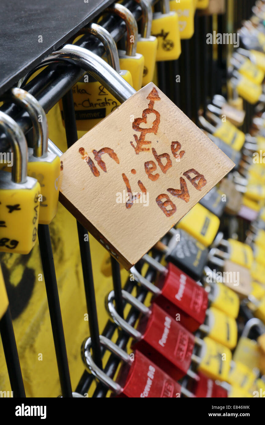 - Love padlock on a fence at the stadium of the german soccer club BVB Borussia Dortmund says 'in love BVB'. - Stock Image