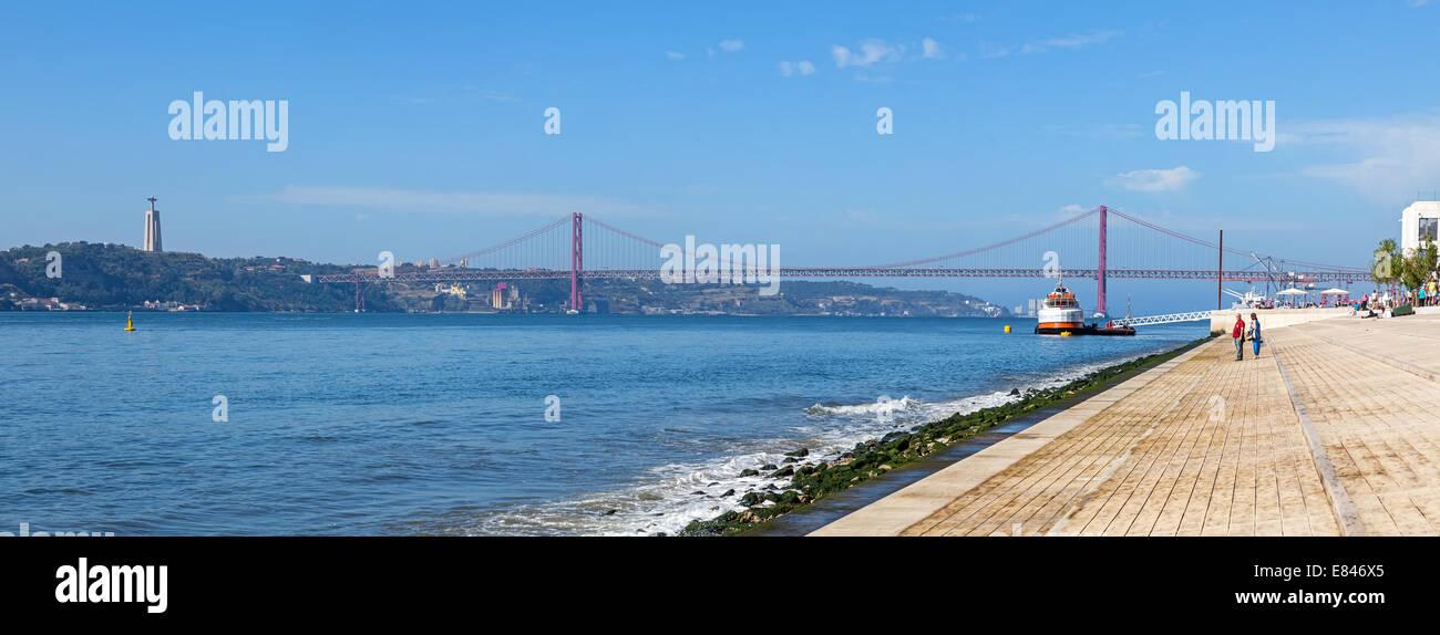 The new Ribeira das Naus area in Lisbon with a view over the Tagus River, the 25 de Abril bridge and the Cristo Stock Photo