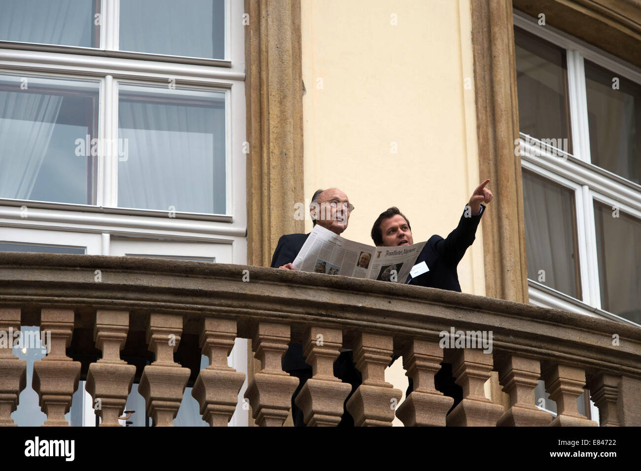 Prague, Czech Republic. 30th Sep, 2014. Former German Foreign Minister Hans-Dietrich Genscher (L) talks to a man Stock Photo