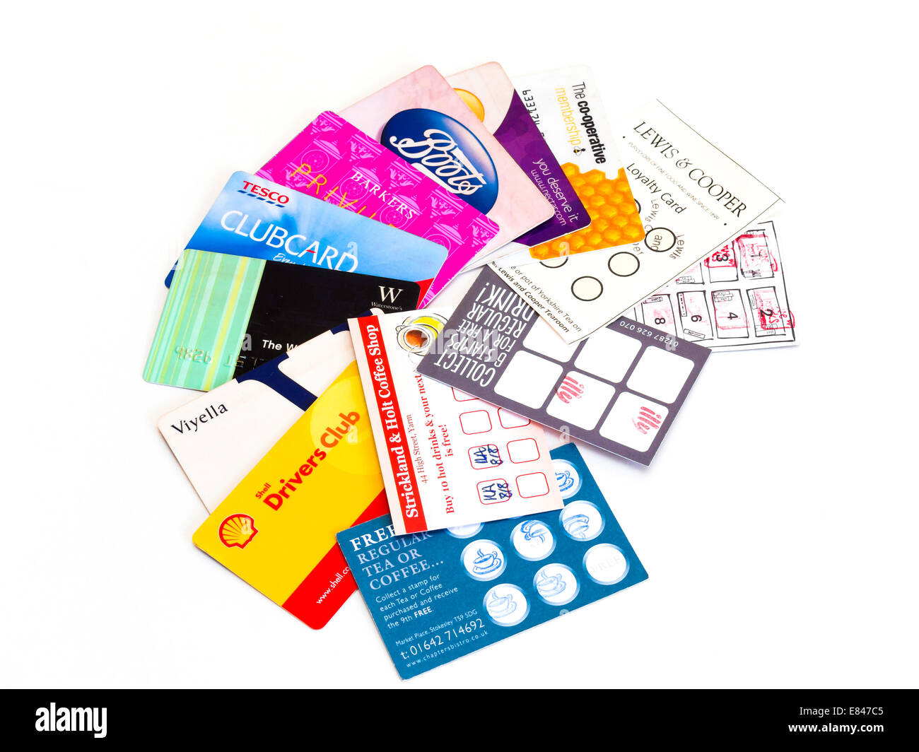 A collection of loyalty cards for cafés restaurants and retail outlets on a white background - Stock Image