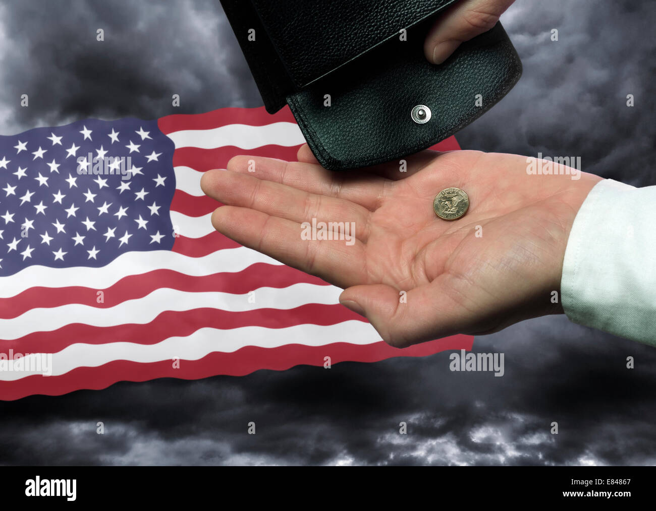 Hand with purse and dollar before the flag of the United States as a symbol of the threat of national bankruptcy - Stock Image