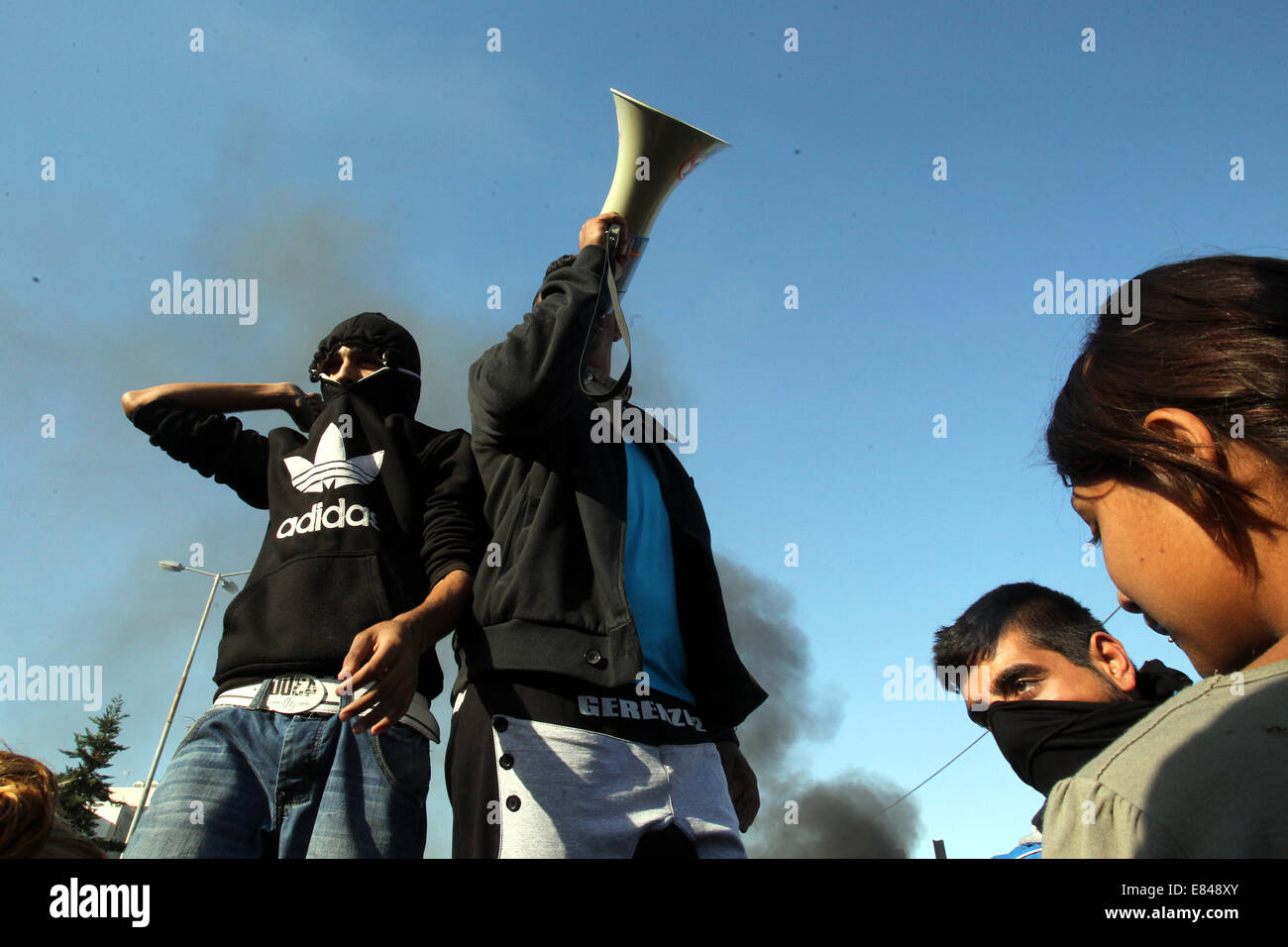 Athens. 30th Sep, 2014. Members of the Greek Roma community attend a protest in Athens, Greece on Sept. 30, 2014. - Stock Image