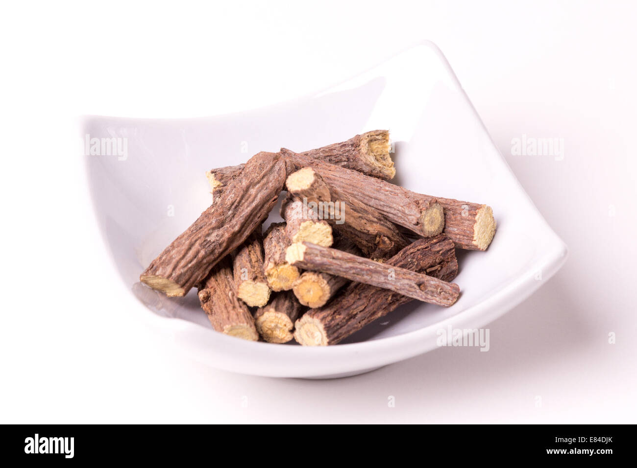 Liquorice root on a white background, studio isolated - Stock Image