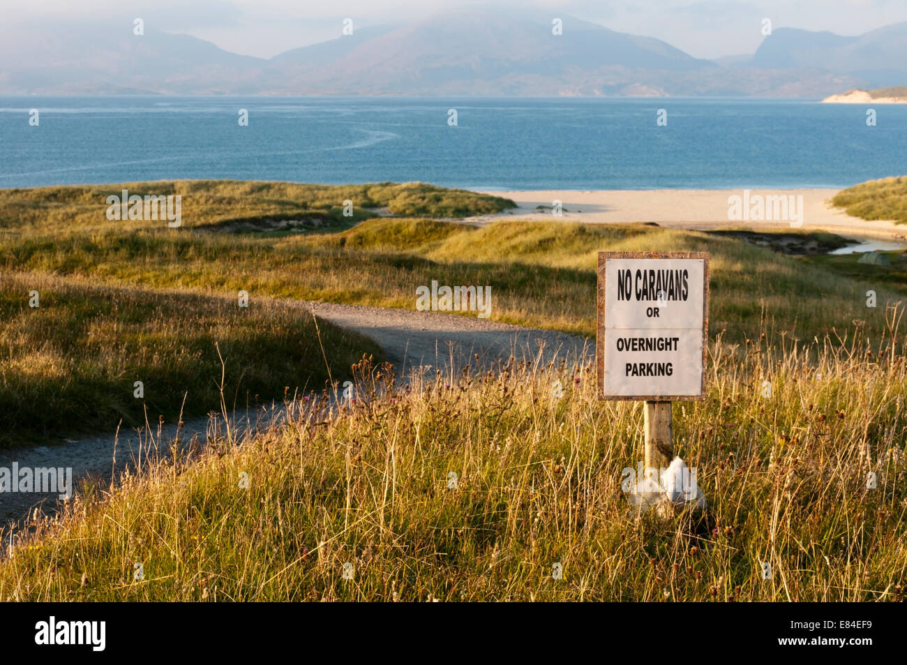 A sign beside Luskentyre Beach on the Isle of Harris prohibits camping or overnight parking. - Stock Image