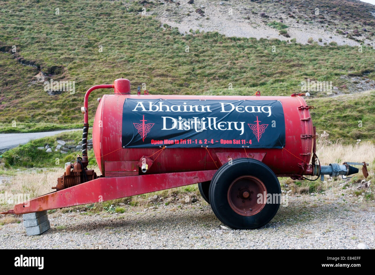 A sign for the Abhainn Dearg single malt whisky distillery on the Isle of Lewis in the Outer Hebrides. - Stock Image