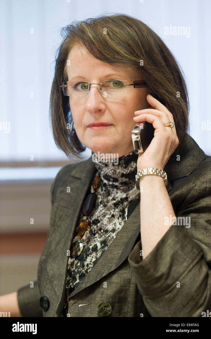 Businesswoman on the phone communicates - Stock Image