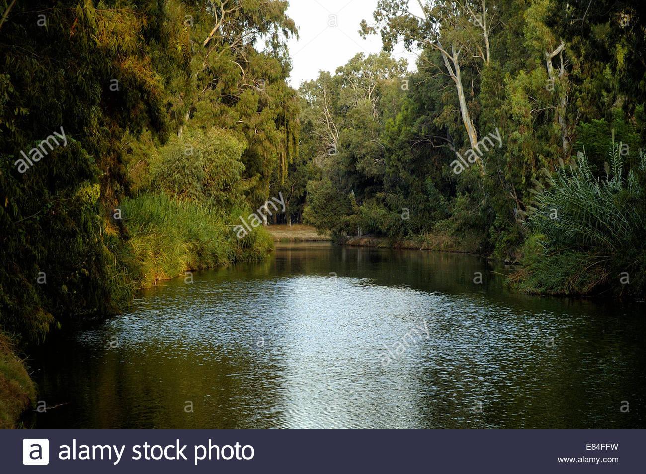View of the Yarkon or Yarqon river which flows west through Gush Dan conurbation and Tel Aviv's Yarkon Park - Stock Image