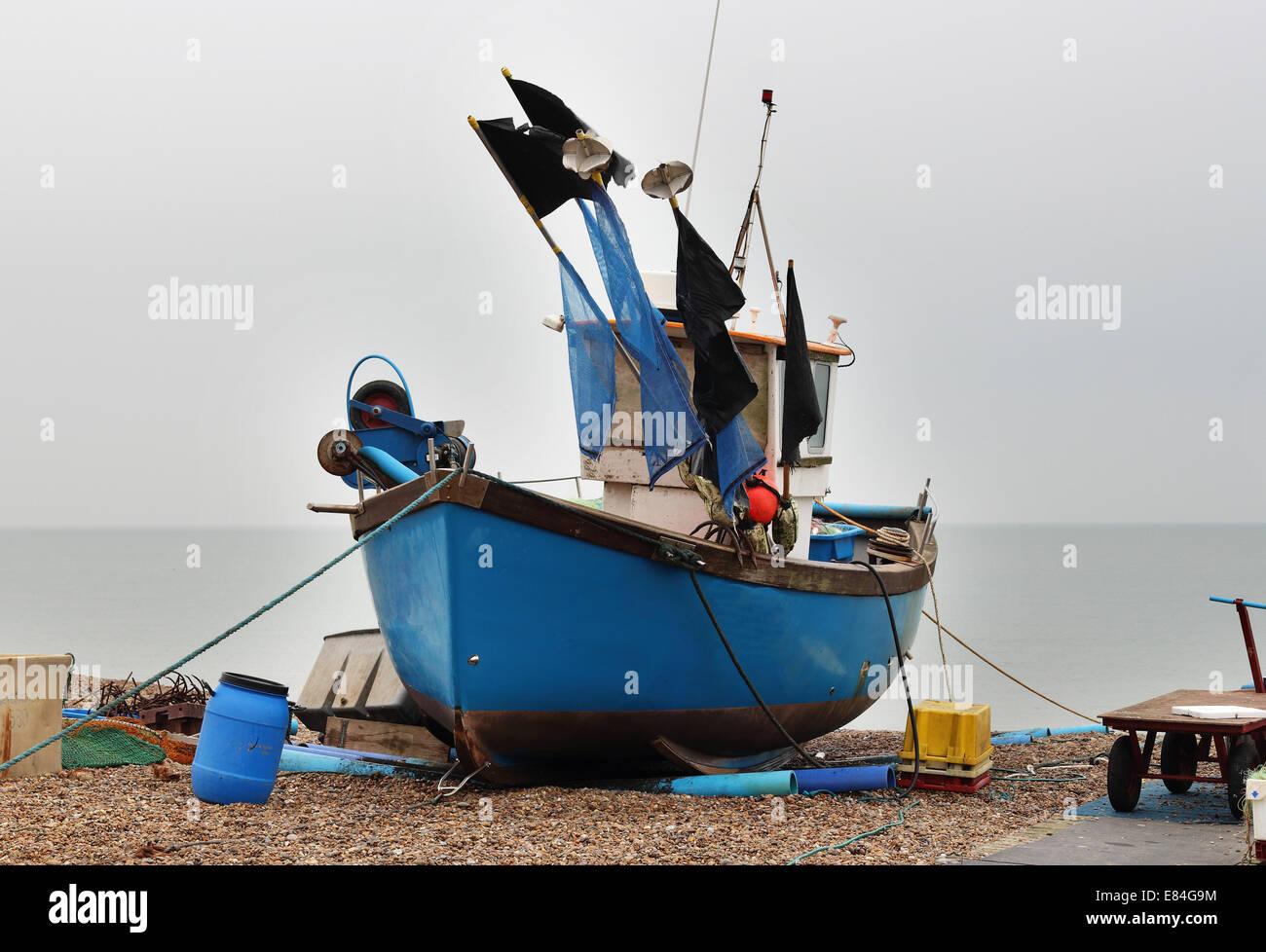 Fishing Boat beached on a Suffolk Shingle beach - Stock Image