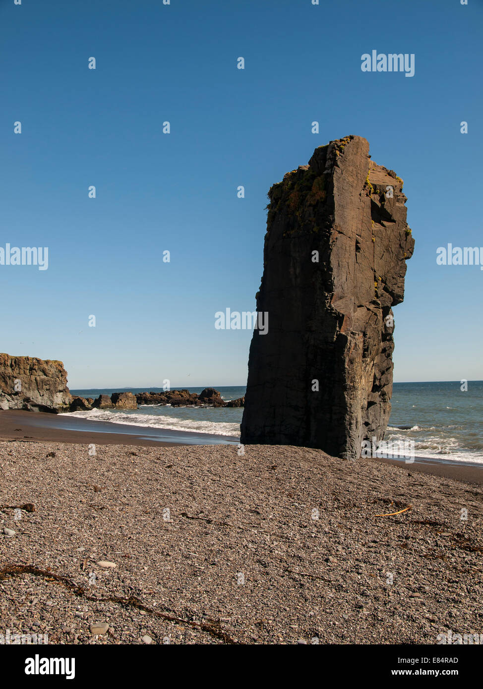 Basaltic geologic formation identified as a mythical troll on a lonely beach in the vicinity of Starmýr. Southeast - Stock Image