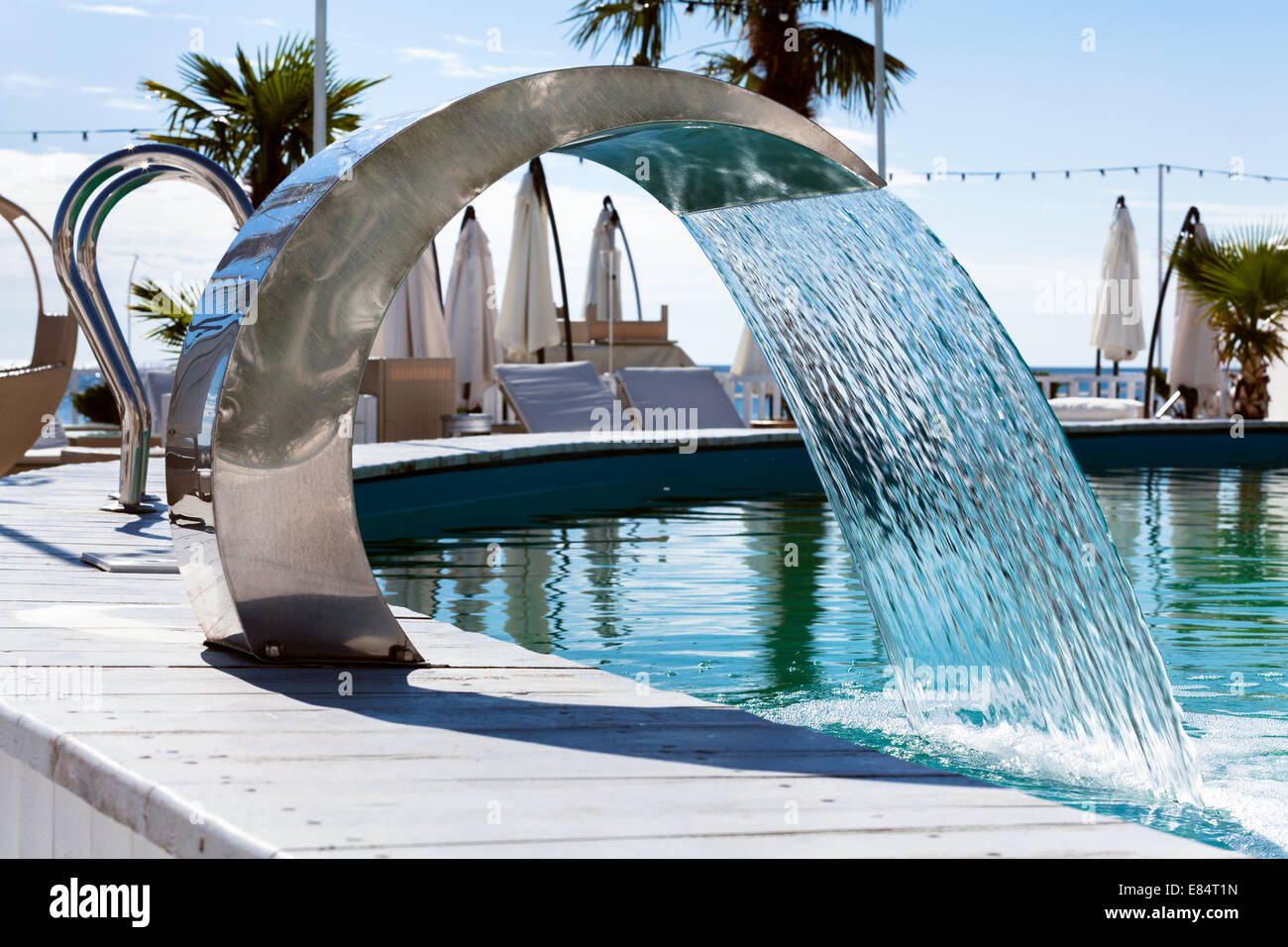 waterfall jet swimming pool - Stock Image
