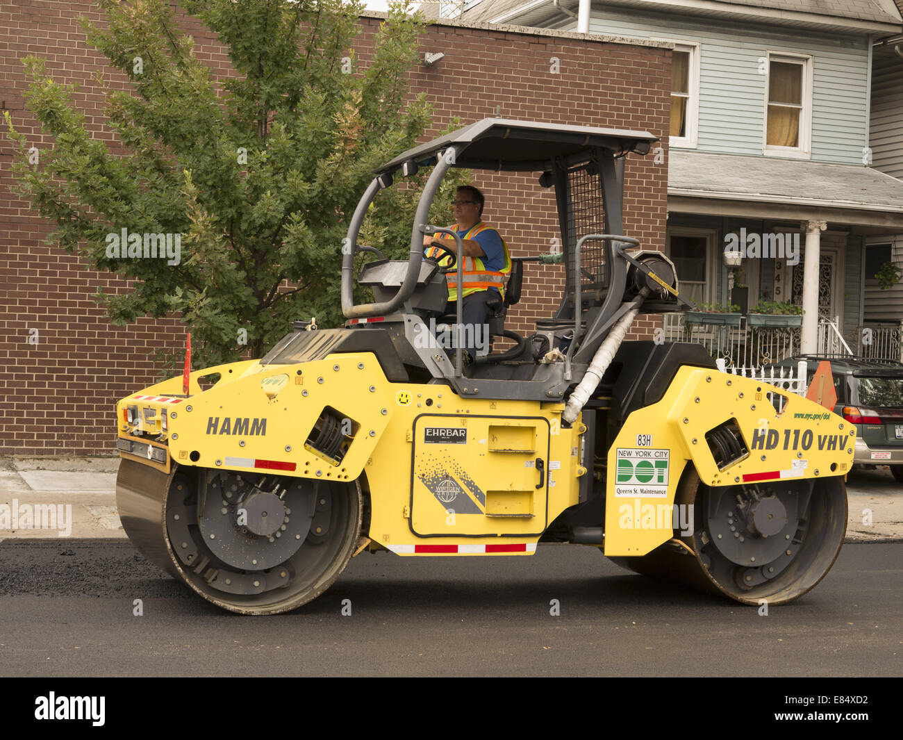 Road crew re-surfaces a street in Brooklyn, NY. - Stock Image