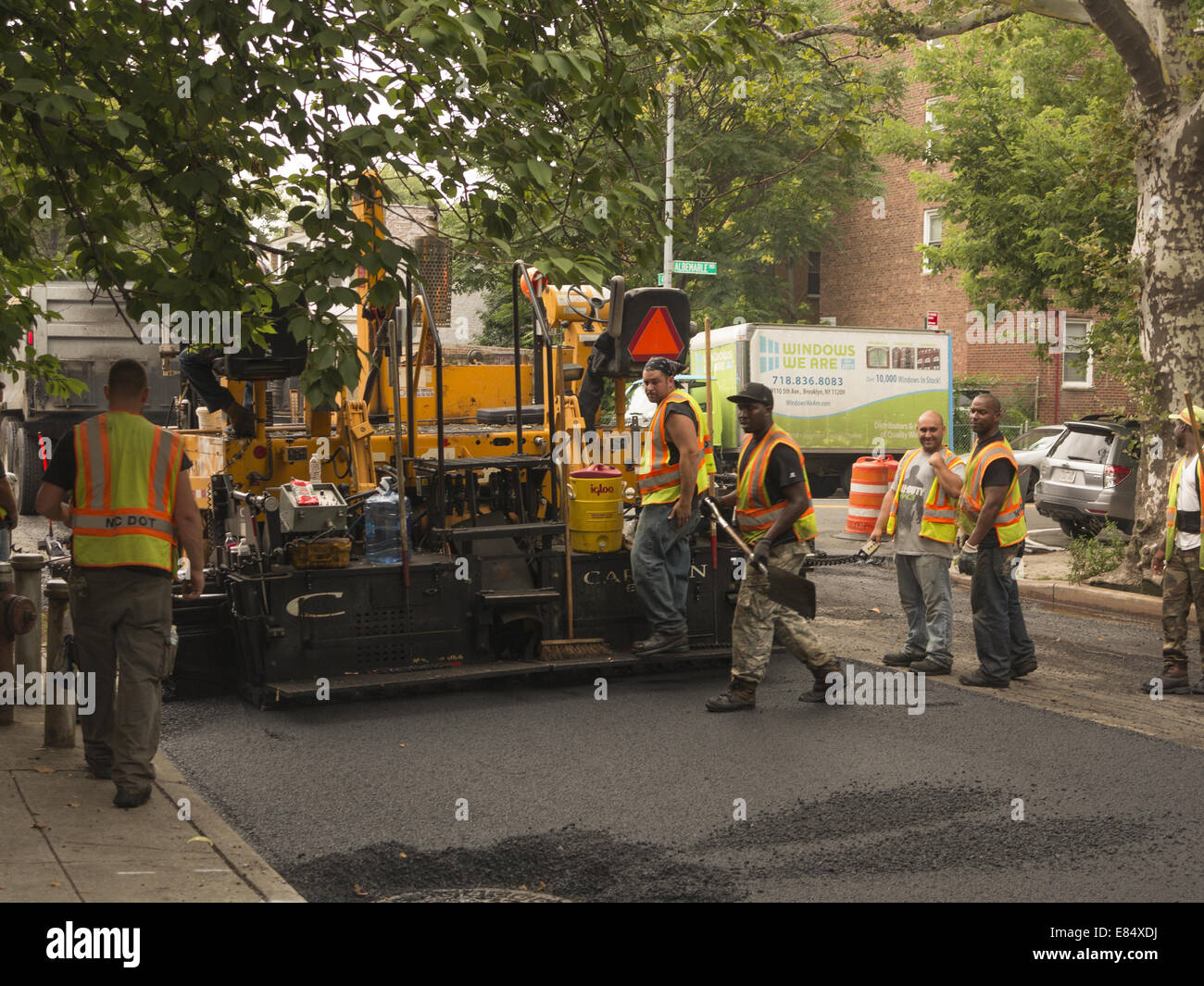 Road crew resurfaces a street in Brooklyn, NY. - Stock Image