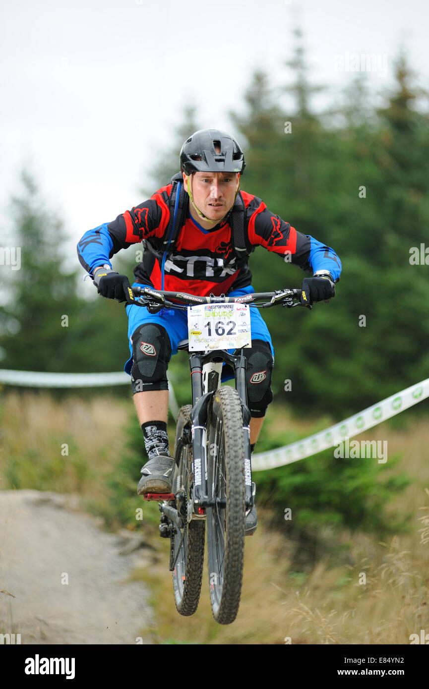Mountain biker taking part in a Enduro race - Stock Image
