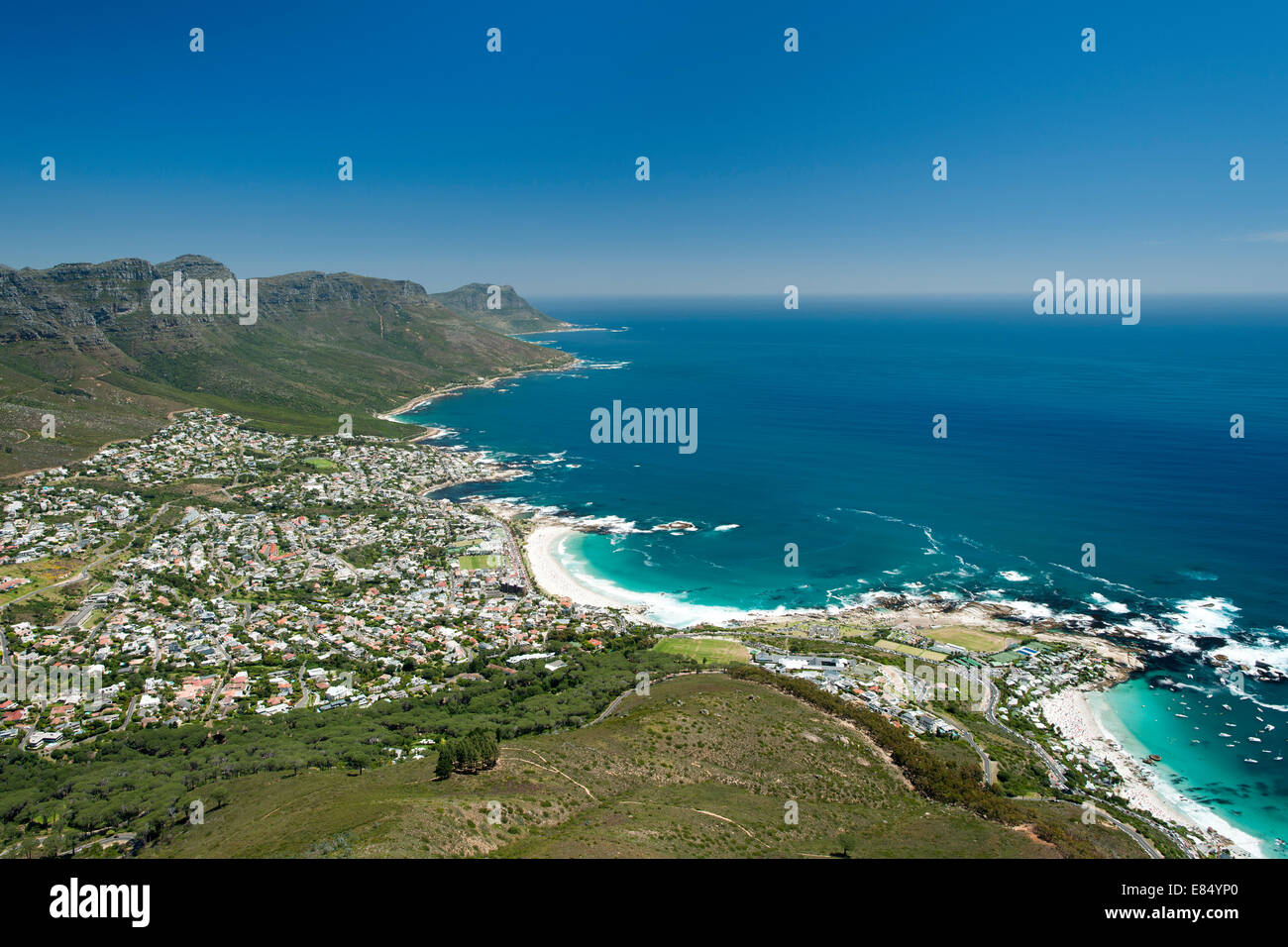 Cape Town's Atlantic seaboard showing the Twelve Apostles mountains and Camps Bay suburb and beach. - Stock Image