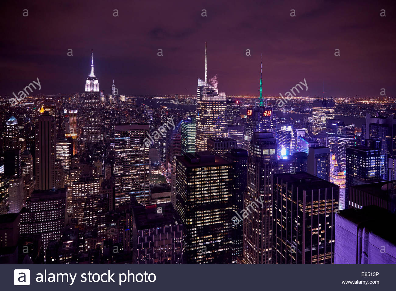New York City Skyline East River Empire State Building Night Moon Airplanes - Stock Image
