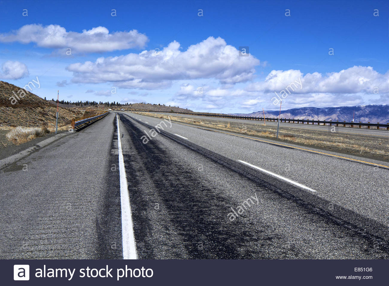 Background Photo Of Side An Open Desert Highway Road Blue Sky With Patchy Clouds