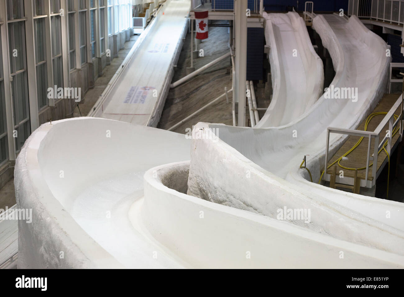 Sliding tracks in the Ice House, a training facility at Canada Olympic Park for sliding sport athletes to practice - Stock Image