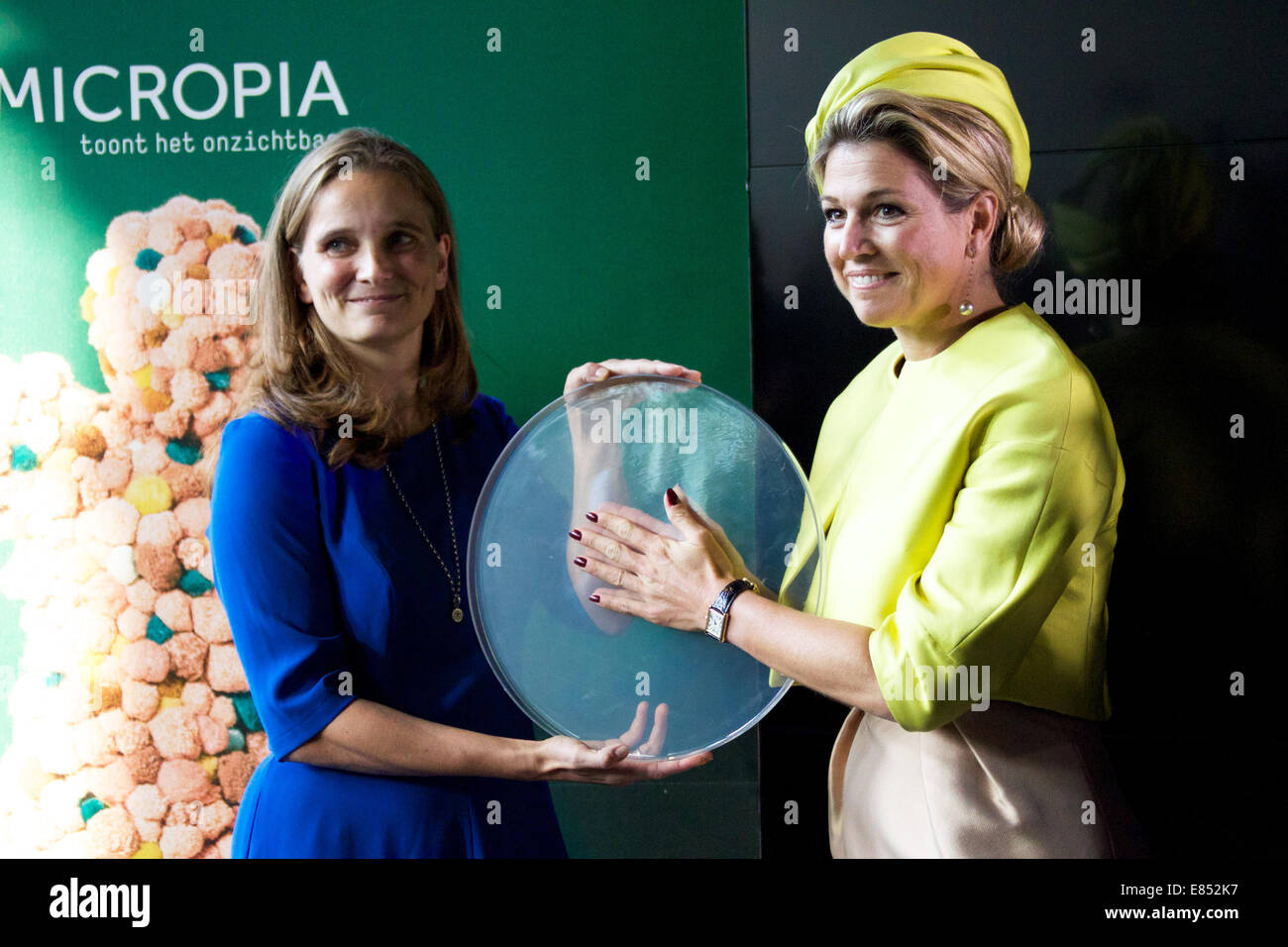 Amsterdam, Netherlands. 30th Sep, 2014. Dutch Queen Maxima (R) attends the opening ceremony of the Micropia Museum, - Stock Image