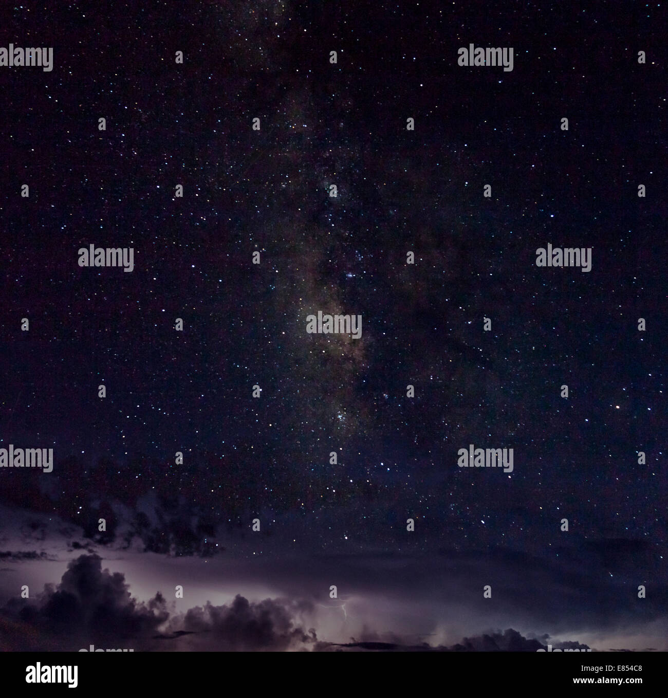 Milky Way and stars above thunderstorm and lightning at the horizon in Big Bend National Park. Stock Photo