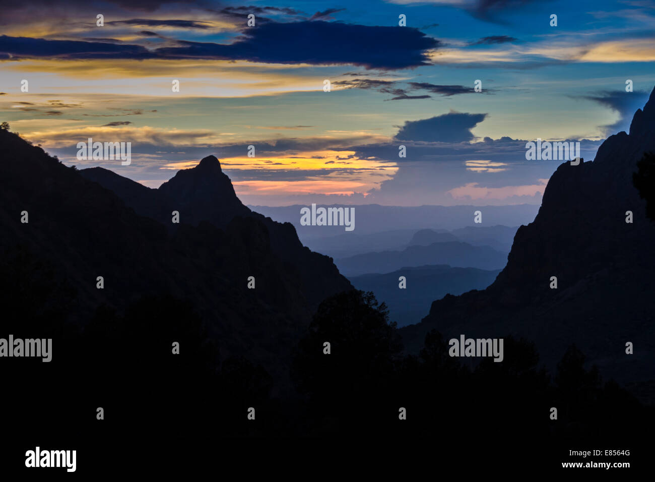 The Window, an iconic view in the Chisos Mountains, silhouetted at sunset in Big Bend National Park. Stock Photo