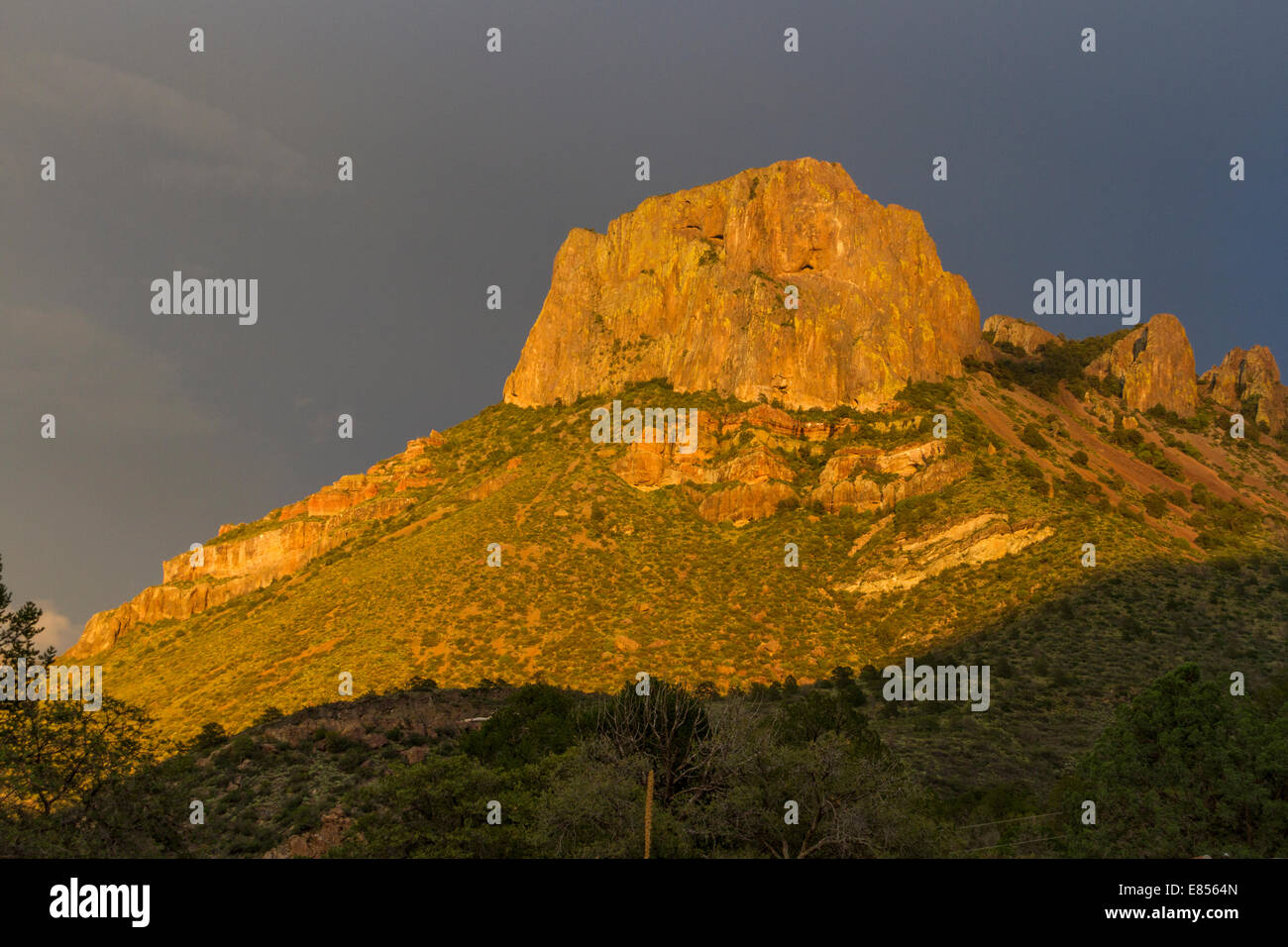 Sunset golden light on Casa Grande Mountain in the Chisos Mountains in Big Bend National Park in West Texas. Stock Photo