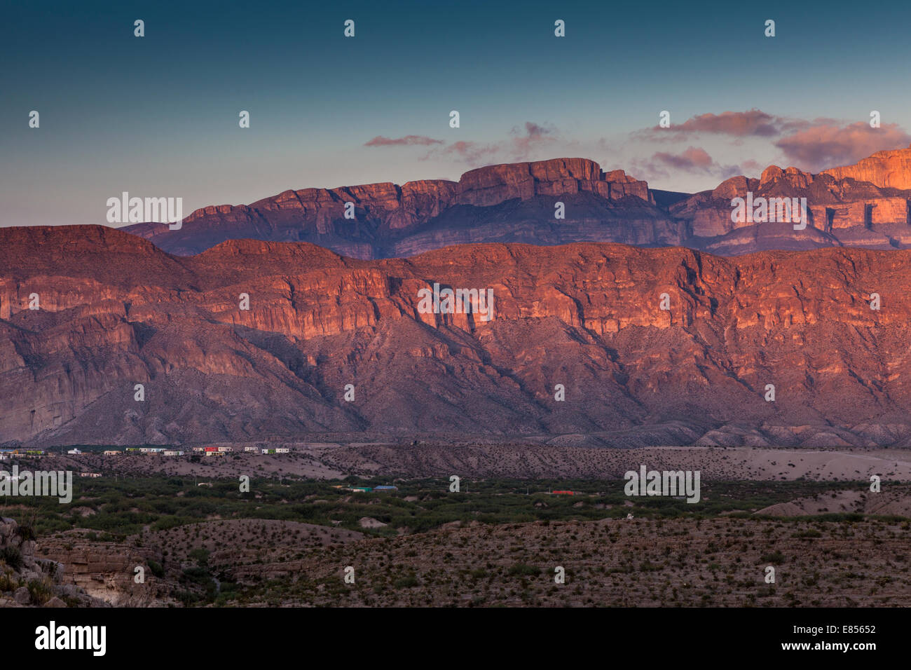 Sunset over the village of Boquillas in Boquillas Canyon with a backdrop of the Sierra del Carmen mountains of Mexico. Stock Photo