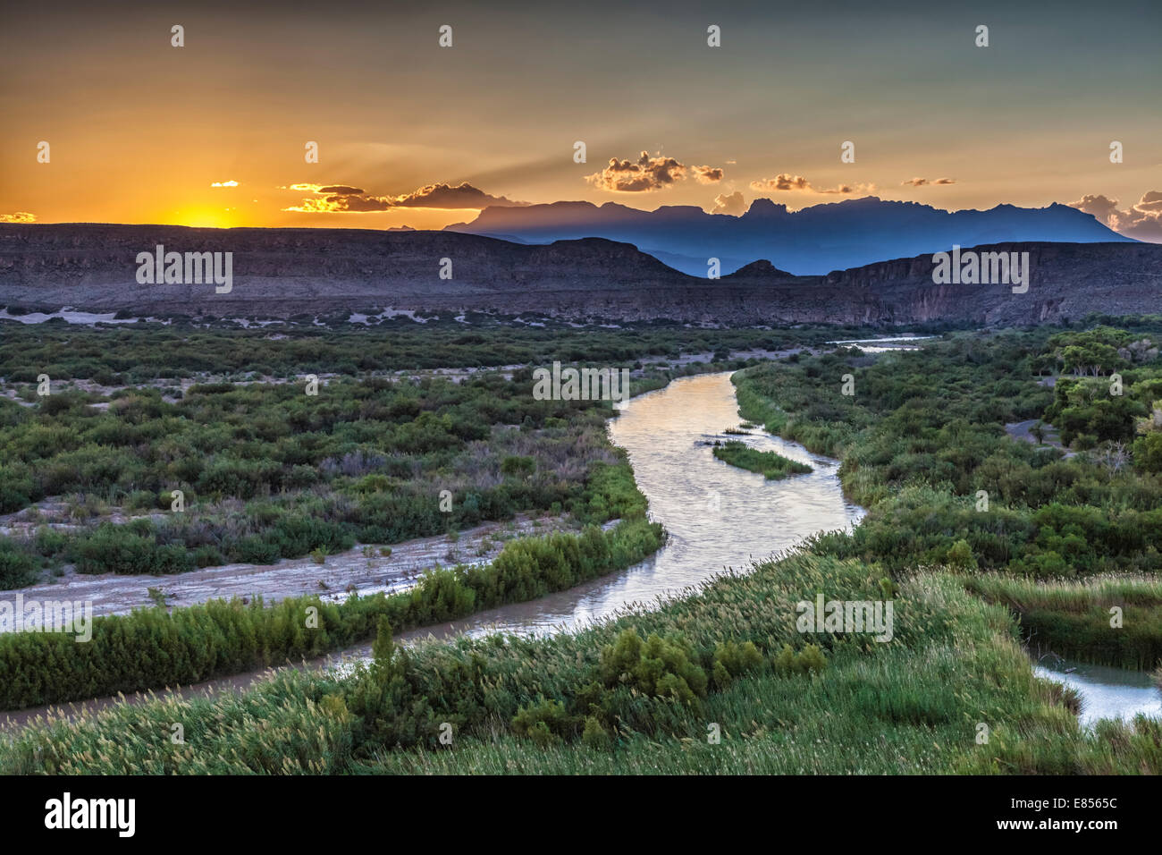 Sunset over Chisos Mountains with Rio Grande River in Big Bend National Park. Stock Photo
