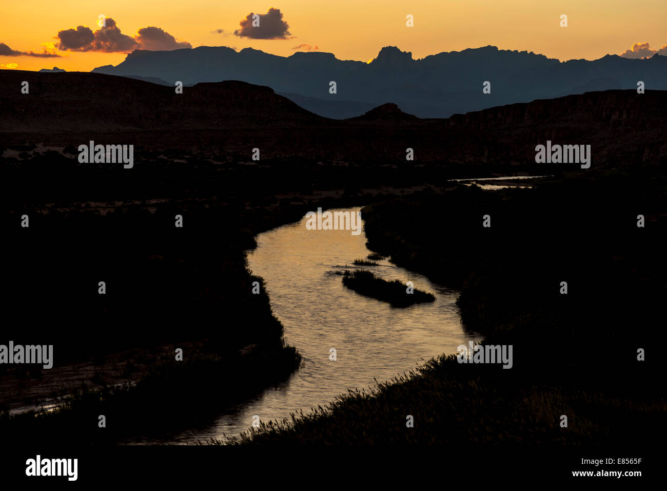 Sunset over Chisos Mountains with Rio Grande River in Big Bend National Park in Southwest Texas. Stock Photo