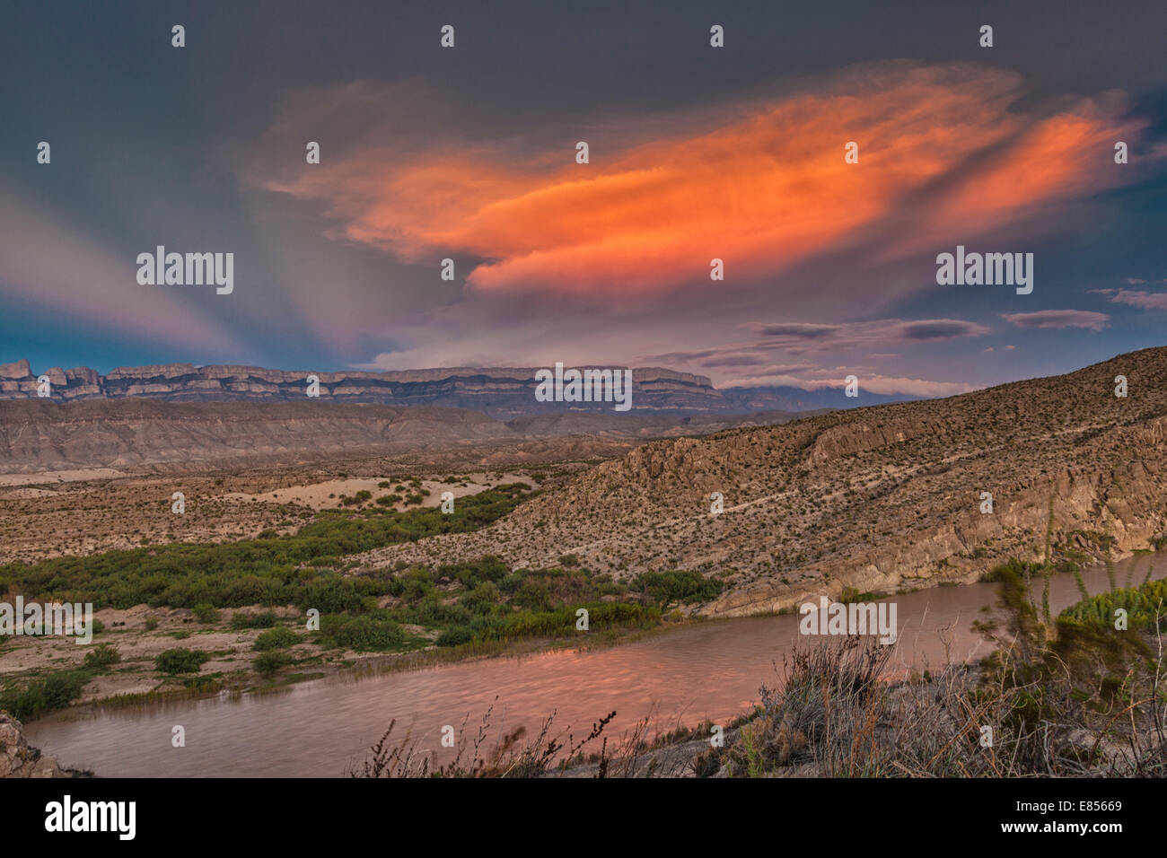 Sunset reflecting in the Rio Grande River in Boquillas Canyon with a backdrop of the Sierra del Carmen Mountains of Mexico. Stock Photo