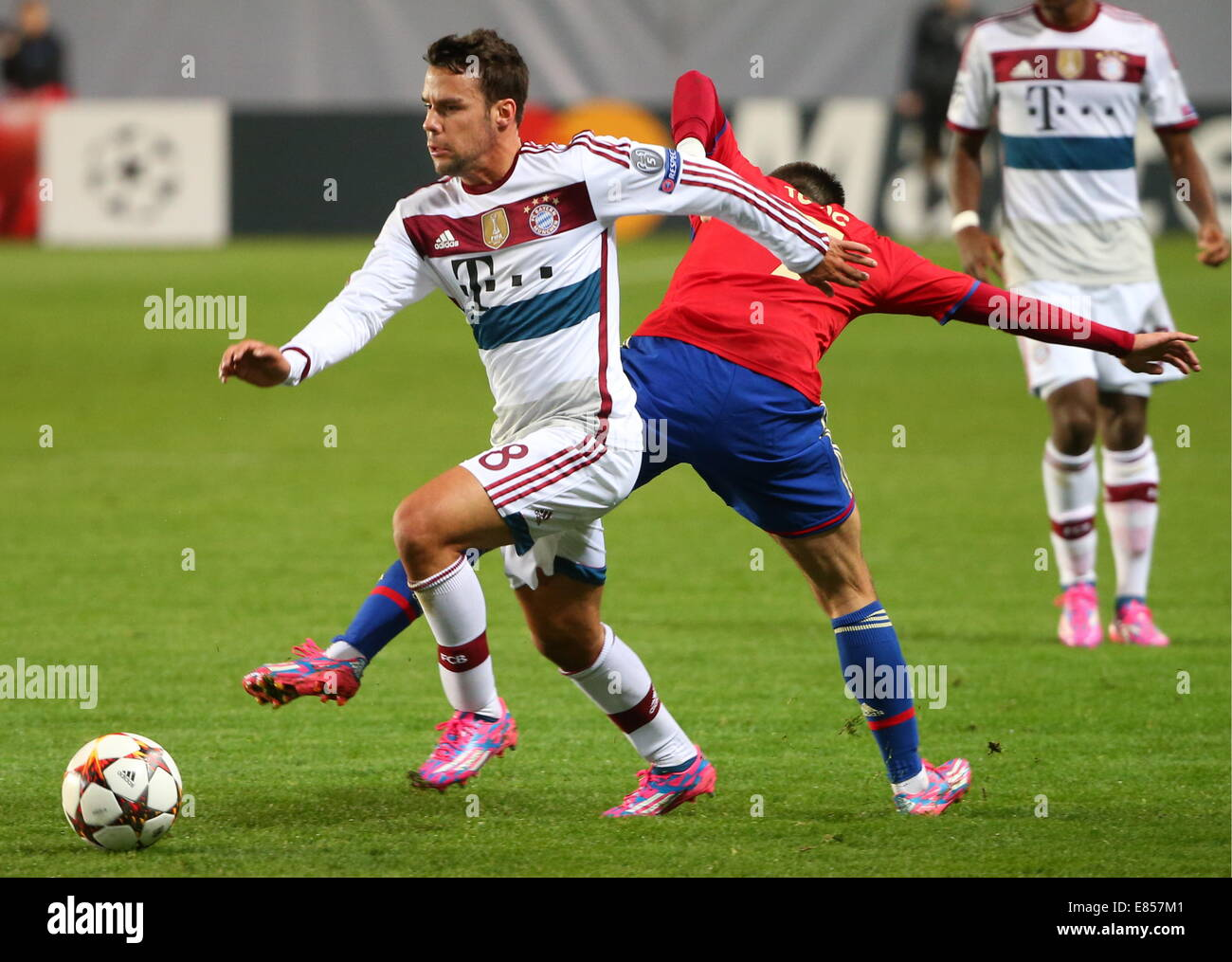 Moscow, Russia. 1st October, 2014.  Bayern's Juan Bernat (L) and CSKA's Zoran Tosic fight for the ball in their Stock Photo