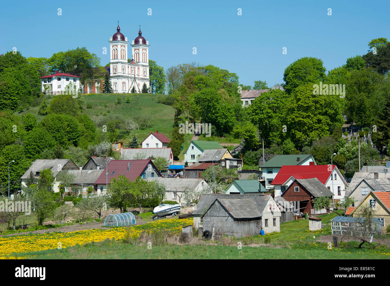 Church of St John the Baptist with the town of Seredzius, Lithuania, Baltic States - Stock Image