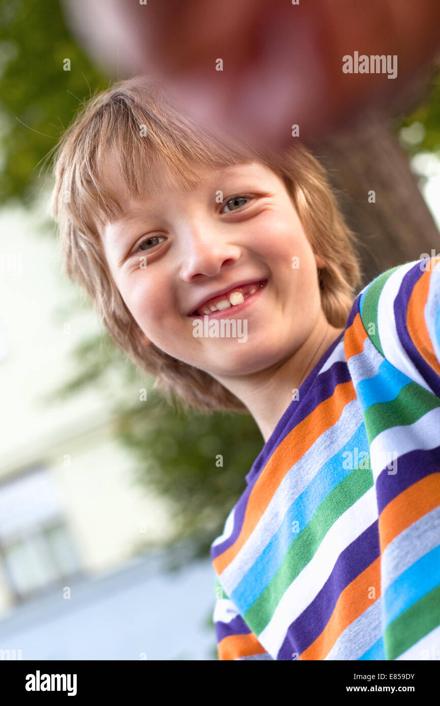 Portrait of a Happy Boy Outdoors Stock Photo