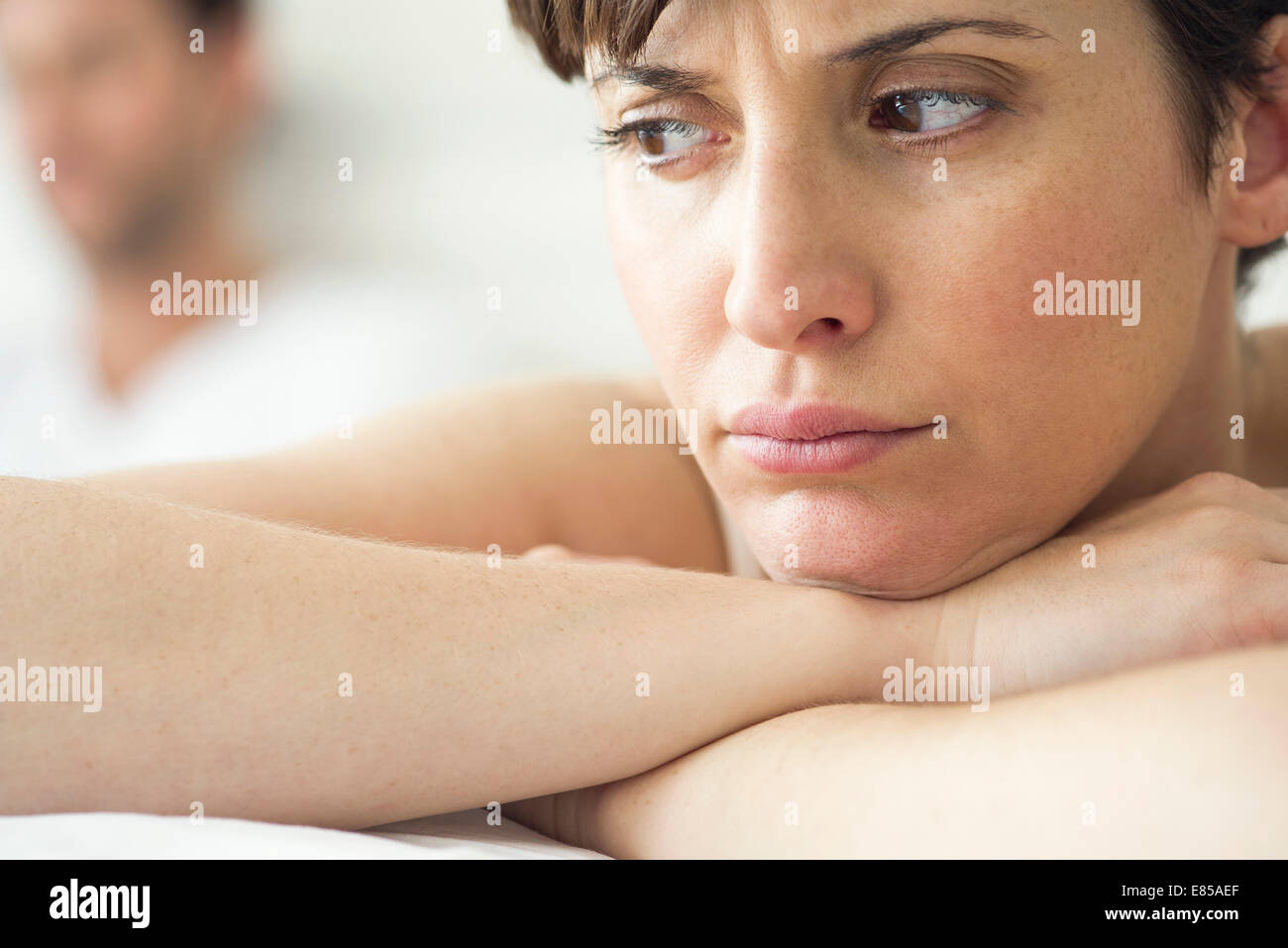 Woman angry and resentful following dispute with husband - Stock Image