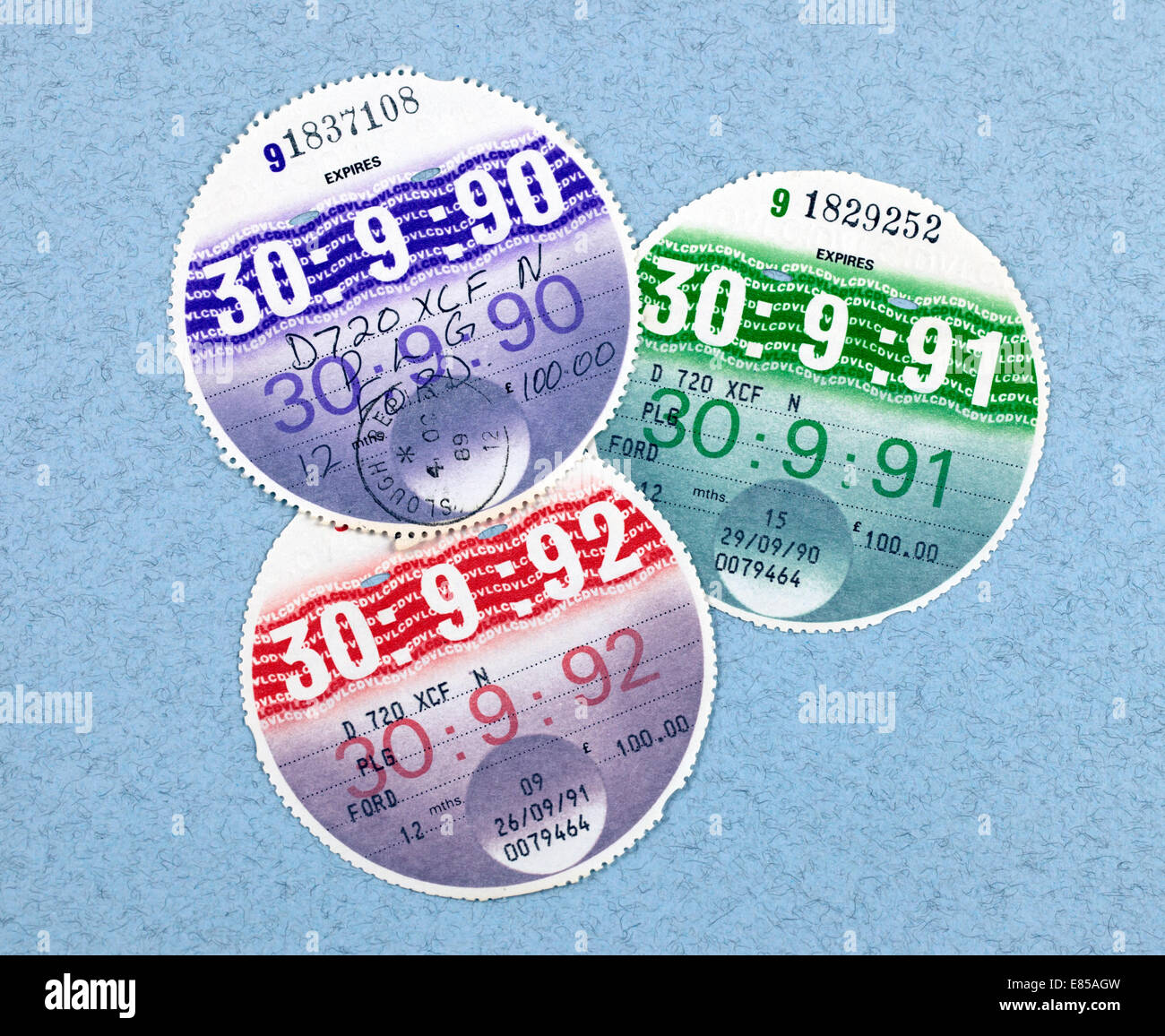 Three old car tax discs from 1990, 1991 and 1992 - Stock Image