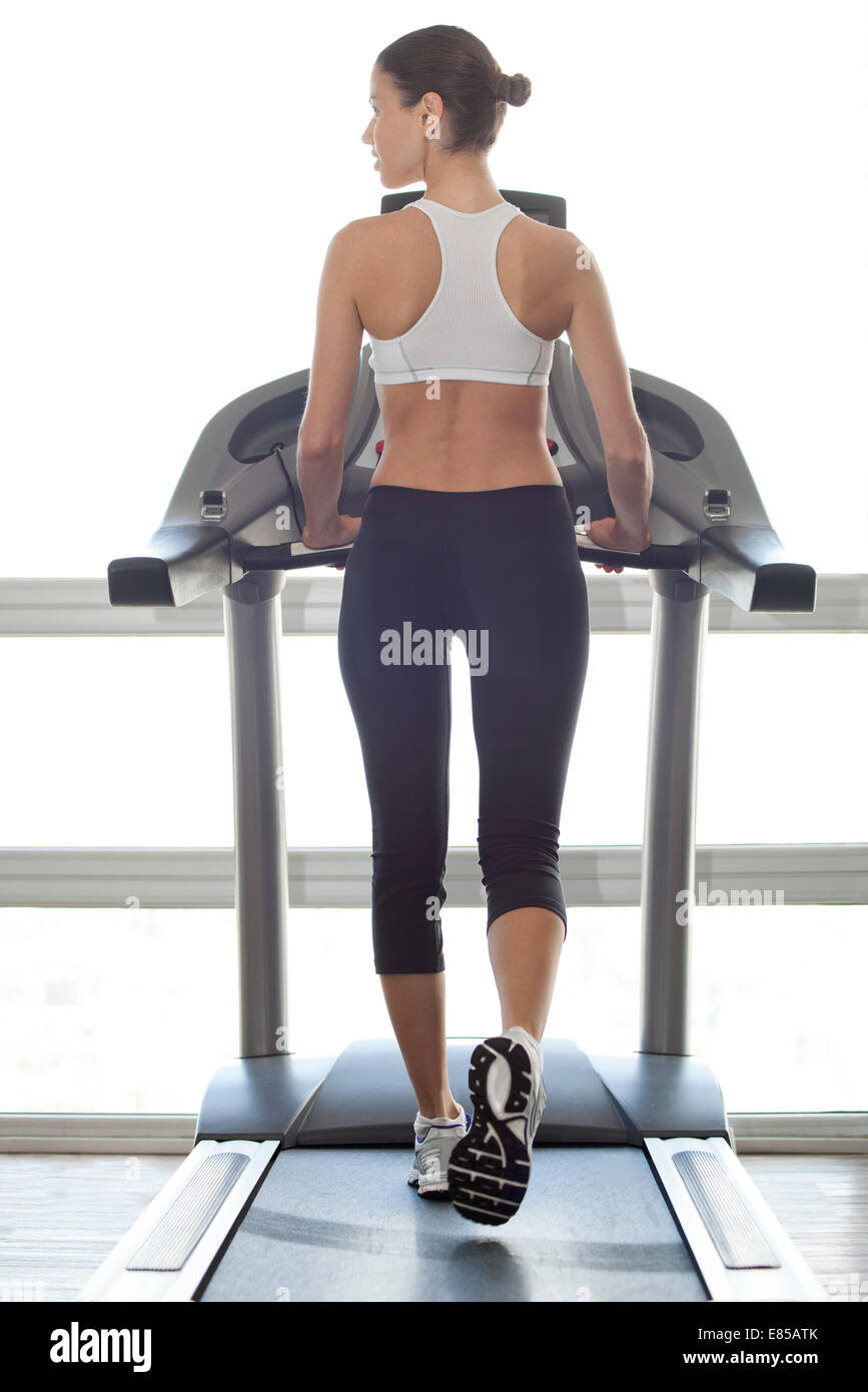 Woman exercising on treadmill - Stock Image