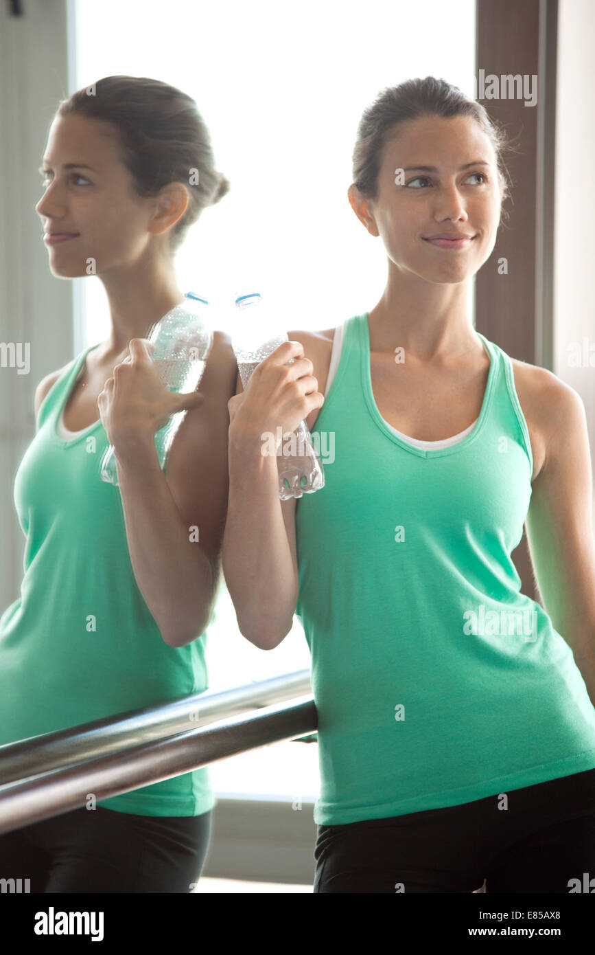 Taking break at gym to hydrate - Stock Image