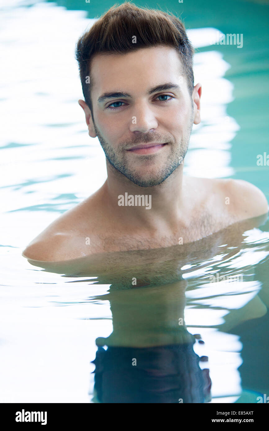 Young man in swimming pool - Stock Image