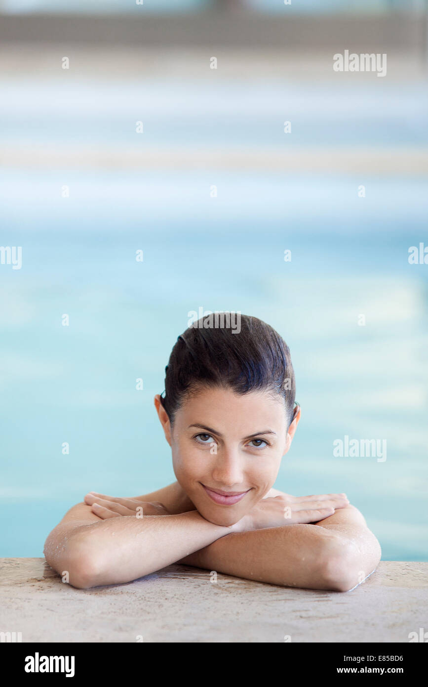 Woman relaxing in swimming pool, portrait Stock Photo