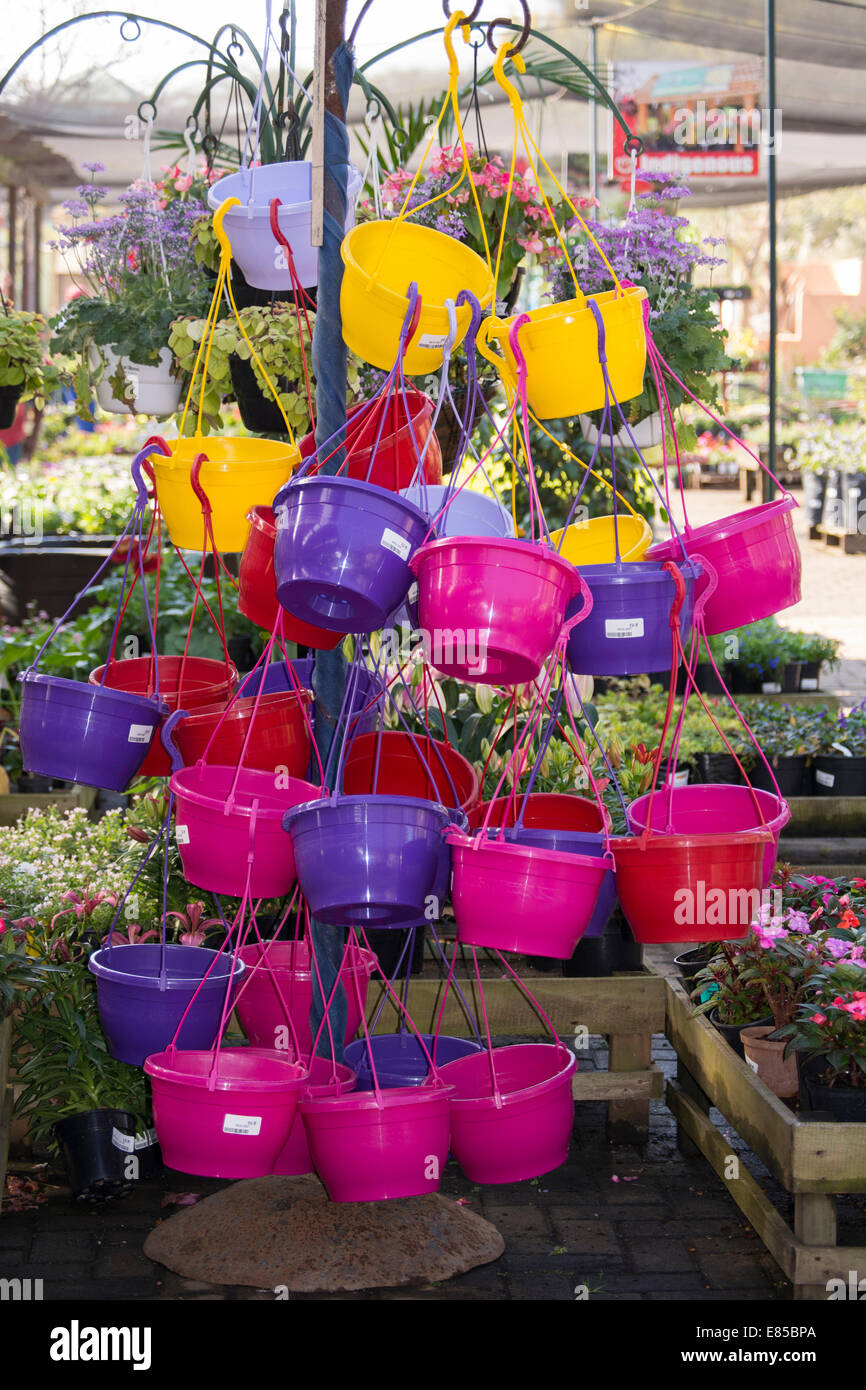 A colorful display of hanging baskets for sale - Stock Image