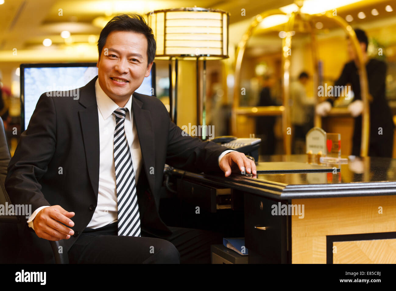 Portrait of hotel service staff - Stock Image