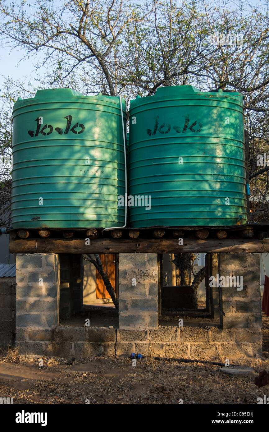 Two water tanks on a solid stand - Stock Image