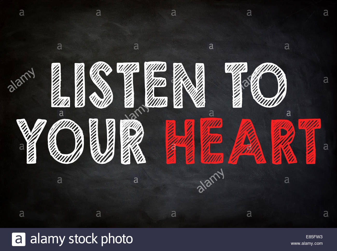 LISTEN TO YOUR HEART- chalkboard concept - Stock Image