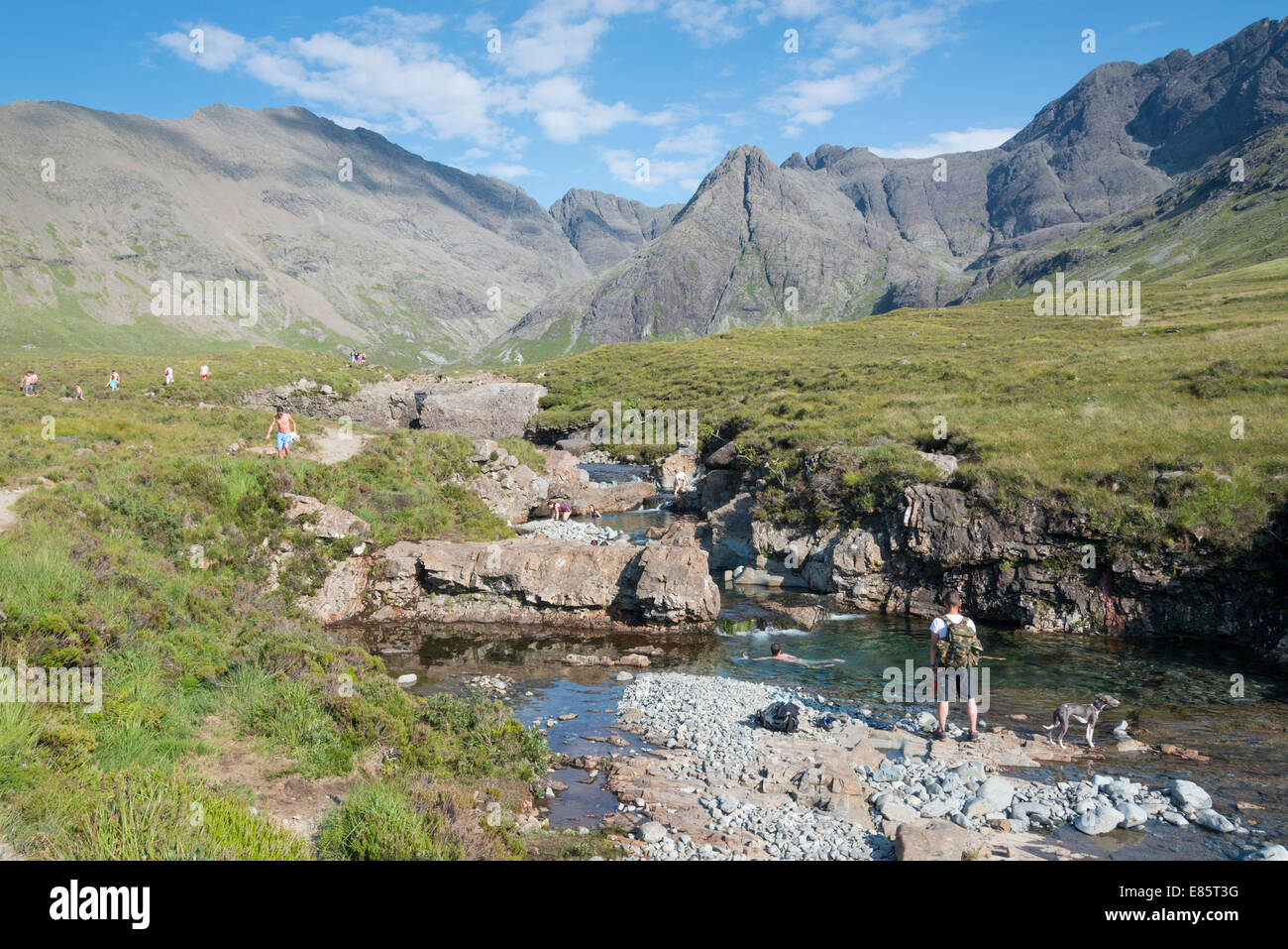 People enjoying the Fairy pools in the Cuillin mountains on the Isle of Skye  Scotland in summer - Stock Image