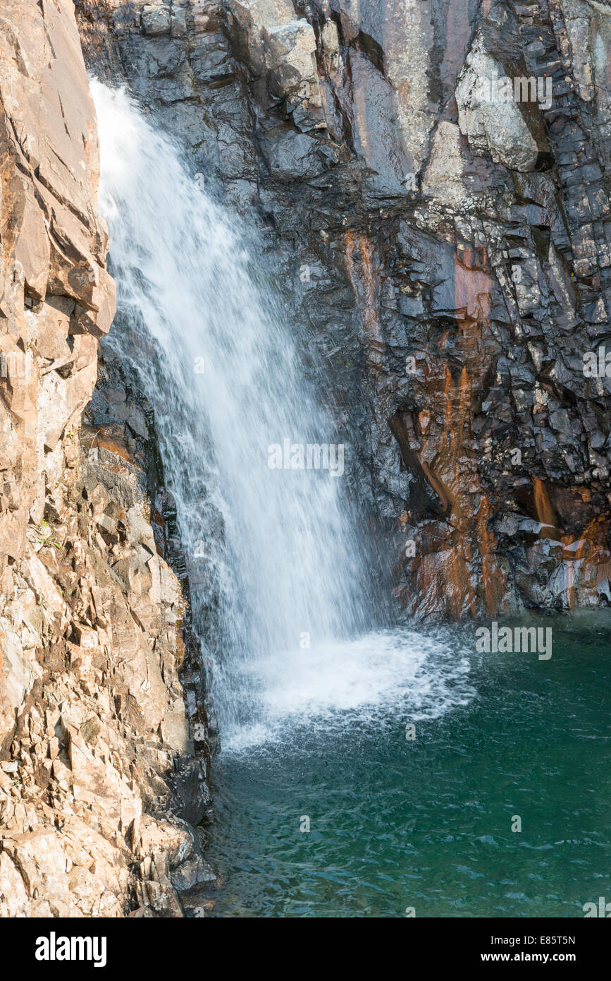 A waterfall on the Fairy pools near the Cuillin mountains Isle of Skye Scotland UK - Stock Image